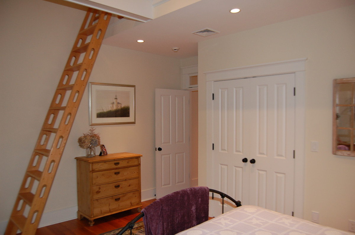Bedroom with wooden ladder to loft