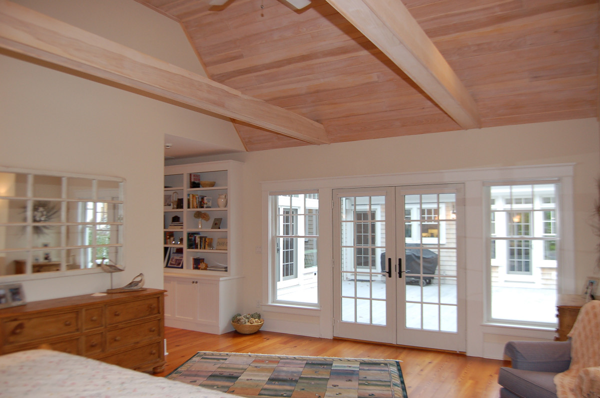 Living room with built-in display shelves and French doors