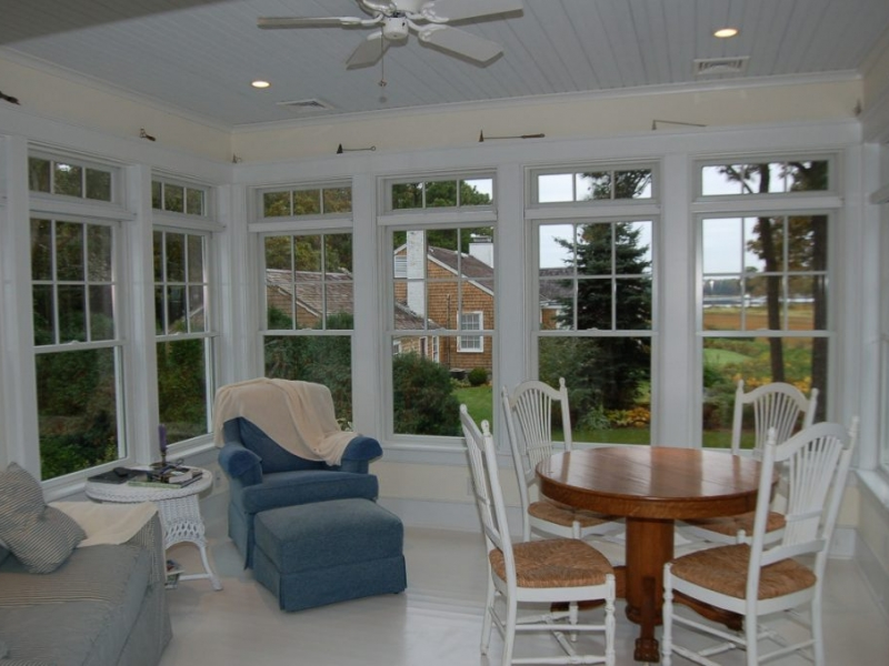 Enclosed glassed-in porch in new home