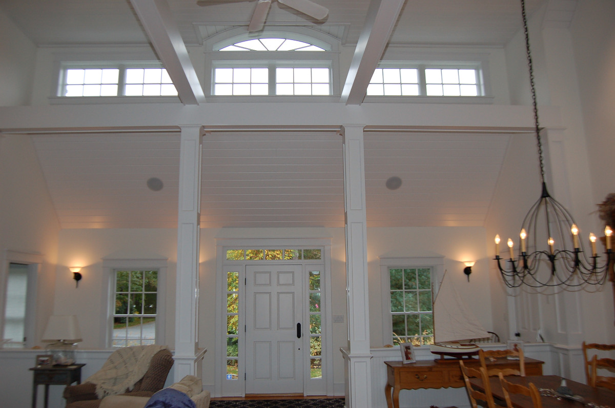 Interior front entry with cathedral ceiling, second floor windows and exposed beams