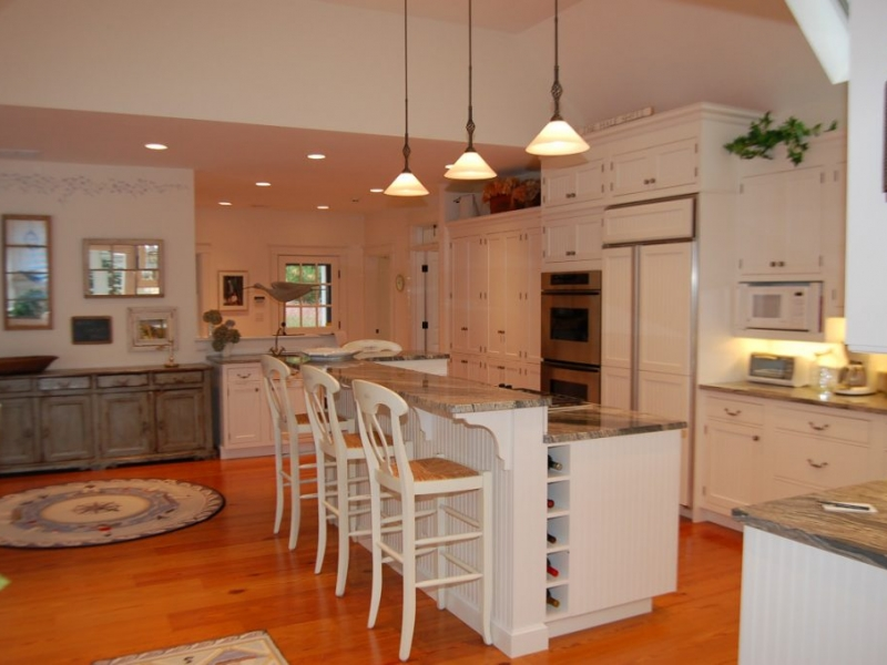 Remodeled kitchen with hardwood floors and marbel-top island