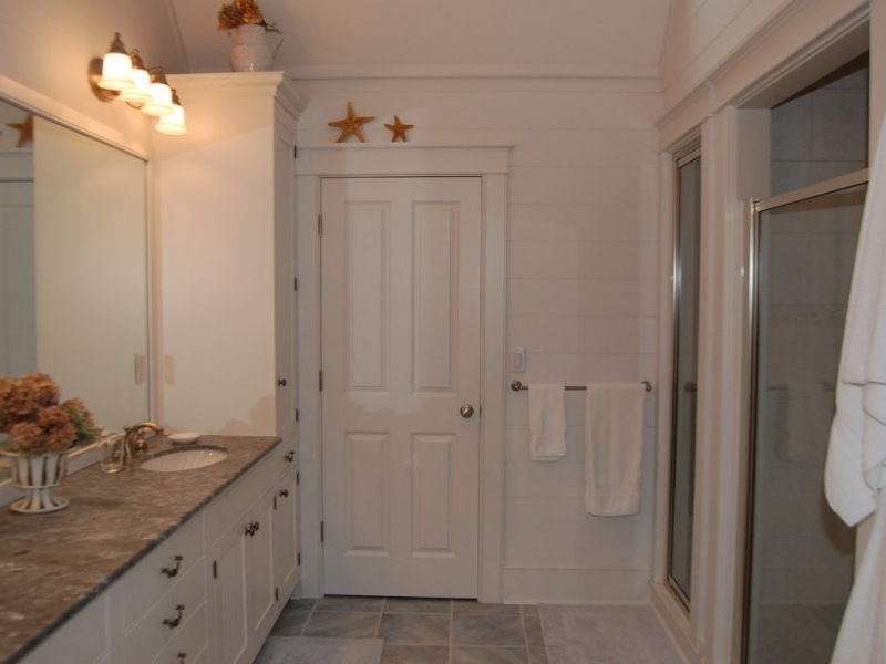 Master bathroom with stone tile floor and double marble vanity