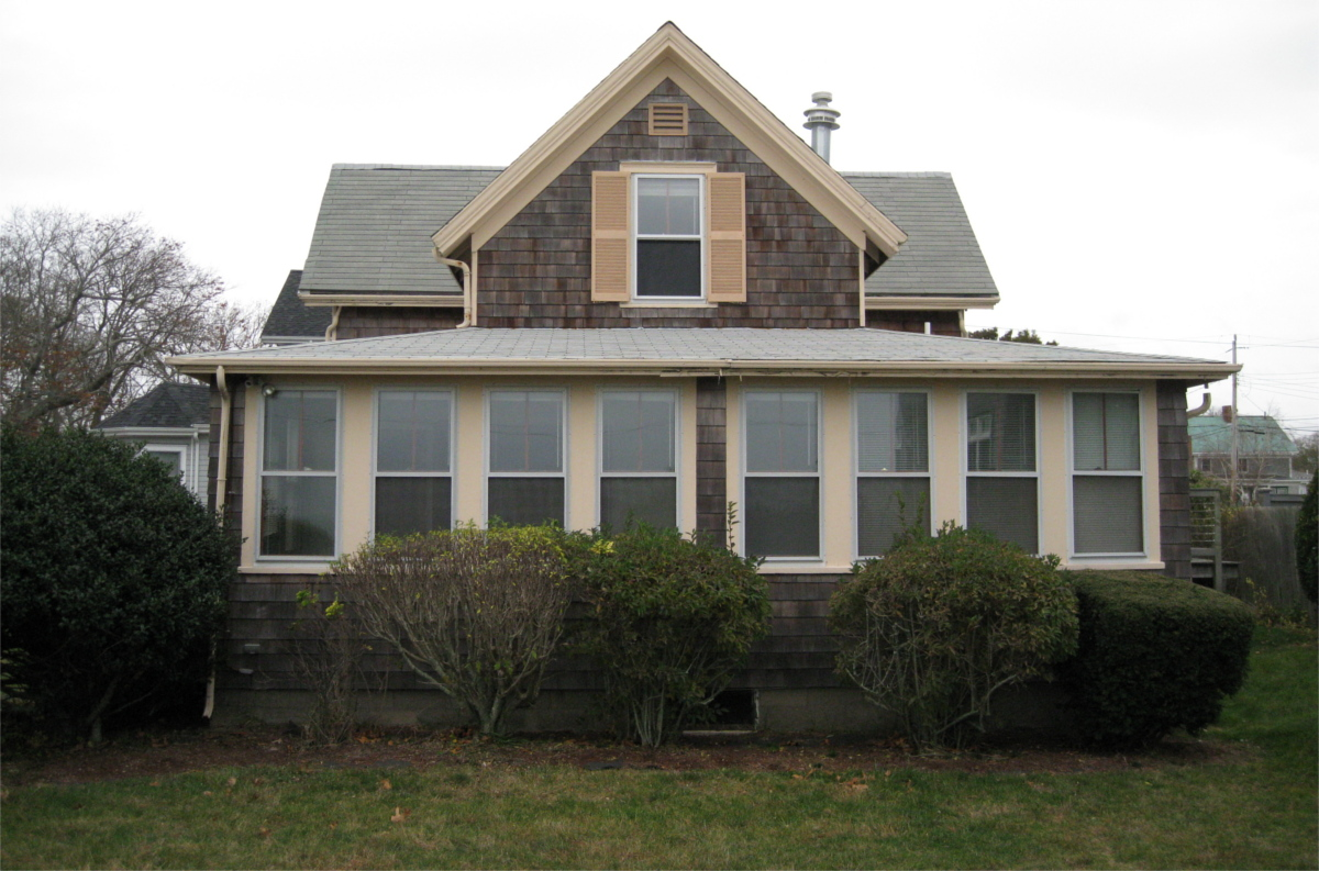 Small dark house in Falmouth before remodeling by Lagadinos Building and Design