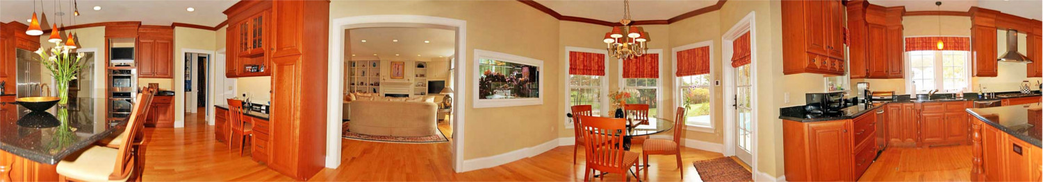 Panoramic image of kitchen and dining area of new home in Mashpee Cape Cod