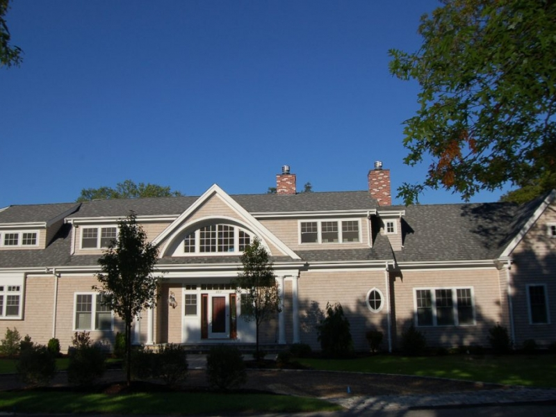 Exterior front entry  with gravel driveway, cobblestone apron, stone steps of Cotuit new home