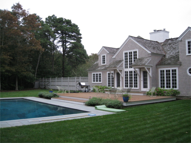 Custom house with pool, view from backyard, after complete renovation