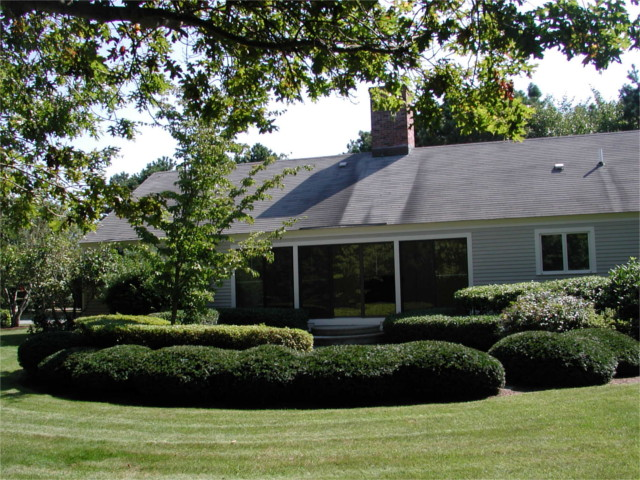 Osterville home, small ranch with bushes, before renovation by Lagadinos Building