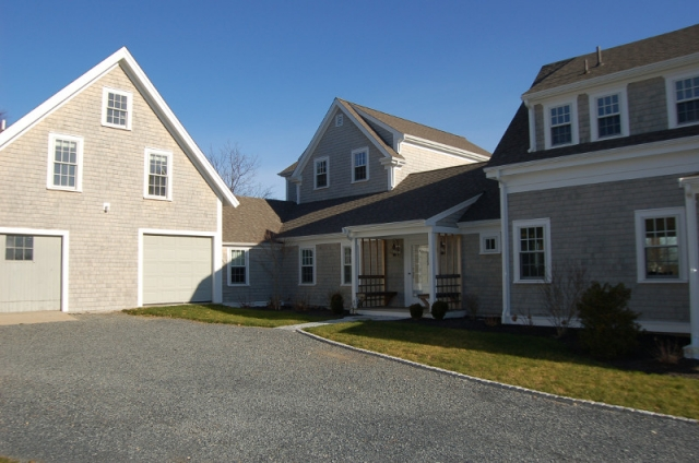 Driveway and renovated farmhouse with barn attached